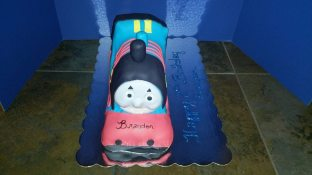 3D Thomas Train cake - frosted in buttercream and covered with fondant.
