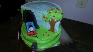 Thomas the Train cut-cake.  Frosted with buttercream, fondant rocks, and toy train.